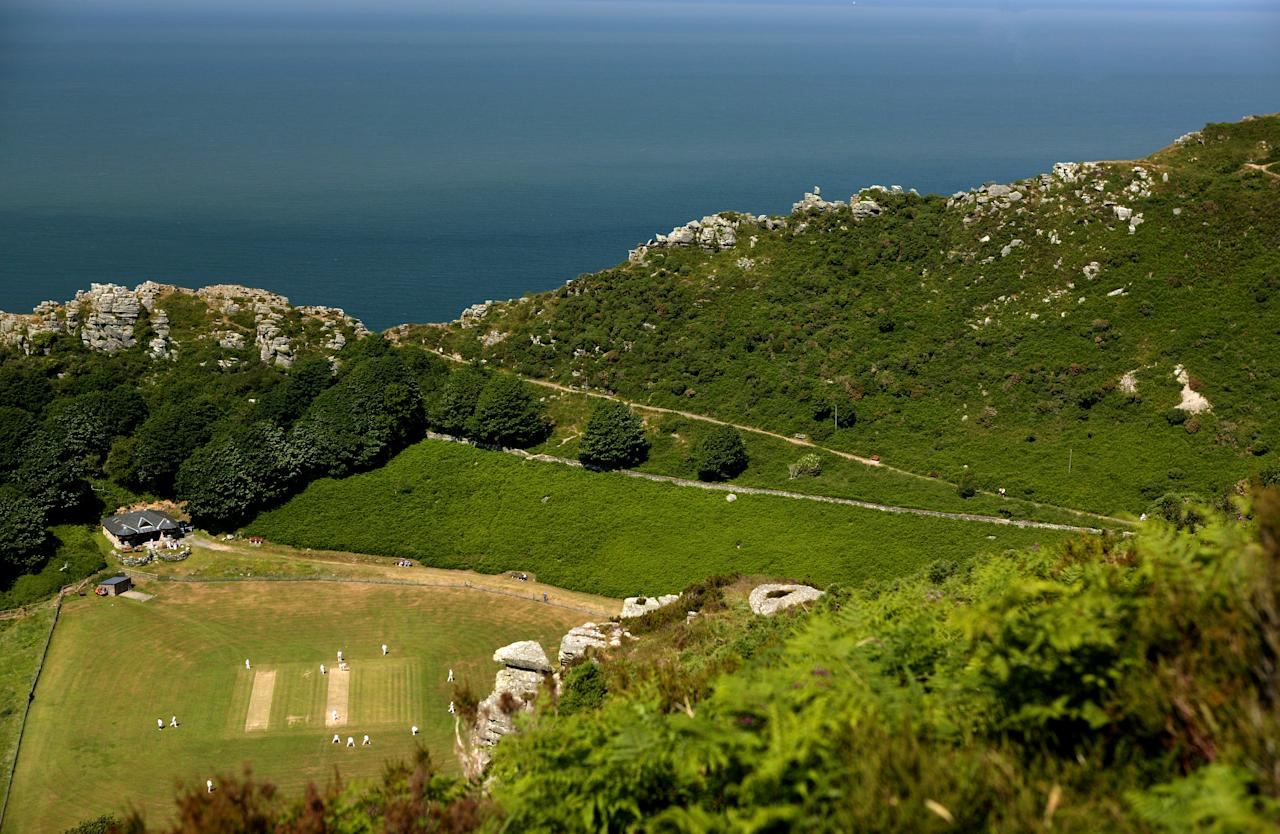 "LYNTON AND LYNMOUTH, ENGLAND - JUNE 26:  Cricketers from Lynton and Lynmouth Cricket Club play in the ""Valley of The Rocks"" on June 26, 2005 in Lynton and Lynmouth, England.  (Photo by Laurence Griffiths/Getty Images)"
