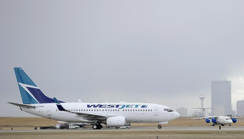 A Westjet Boeing 737-700 takes off at the International Airport in Calgary