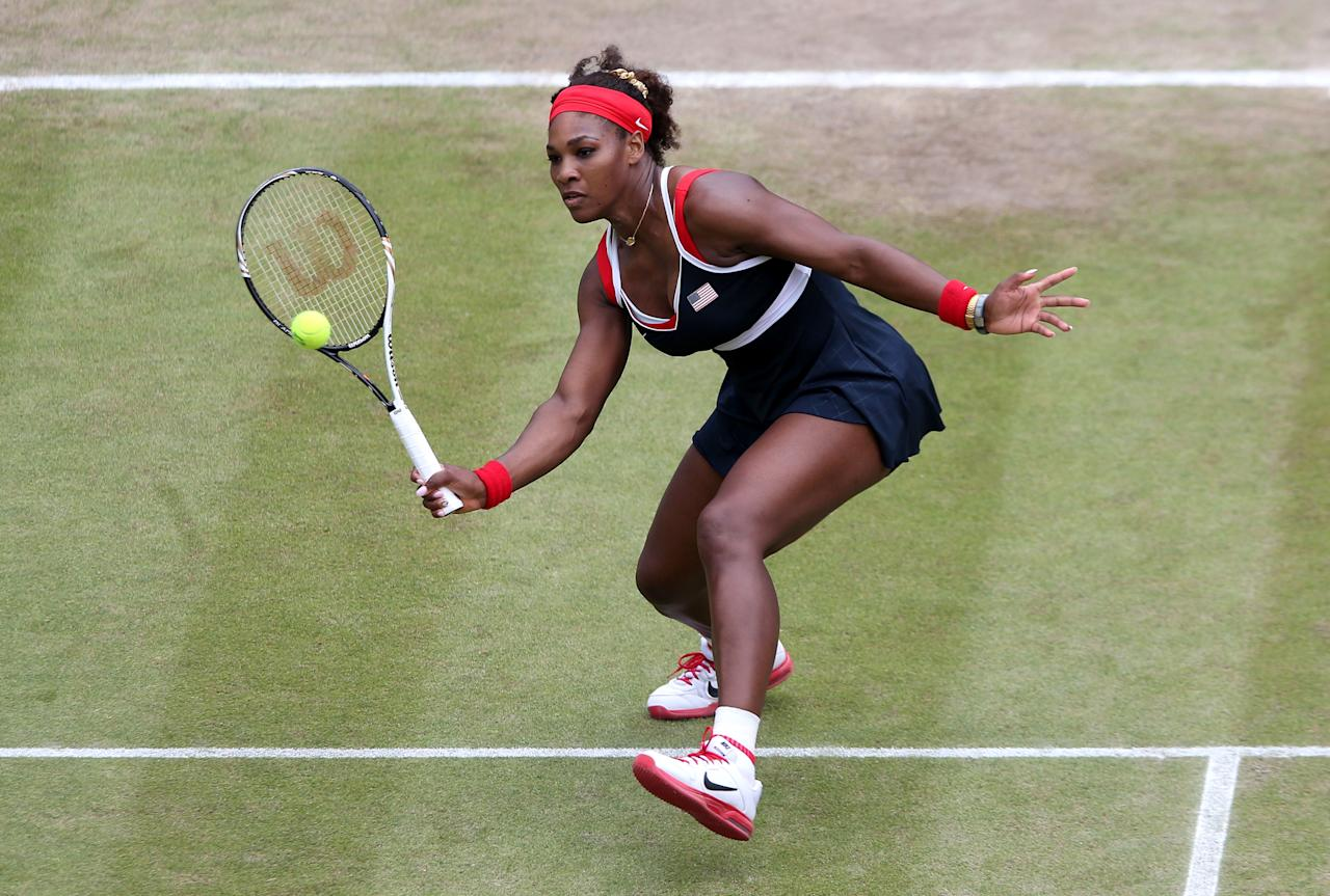 LONDON, ENGLAND - AUGUST 02:  Serena Williams of the United States returns a shot to Caroline Wozniacki of Denmark in the Quarterfinals of Women's Singles Tennis on Day 6 of the London 2012 Olympic Games at Wimbledon on August 2, 2012 in London, England.  (Photo by Clive Brunskill/Getty Images)