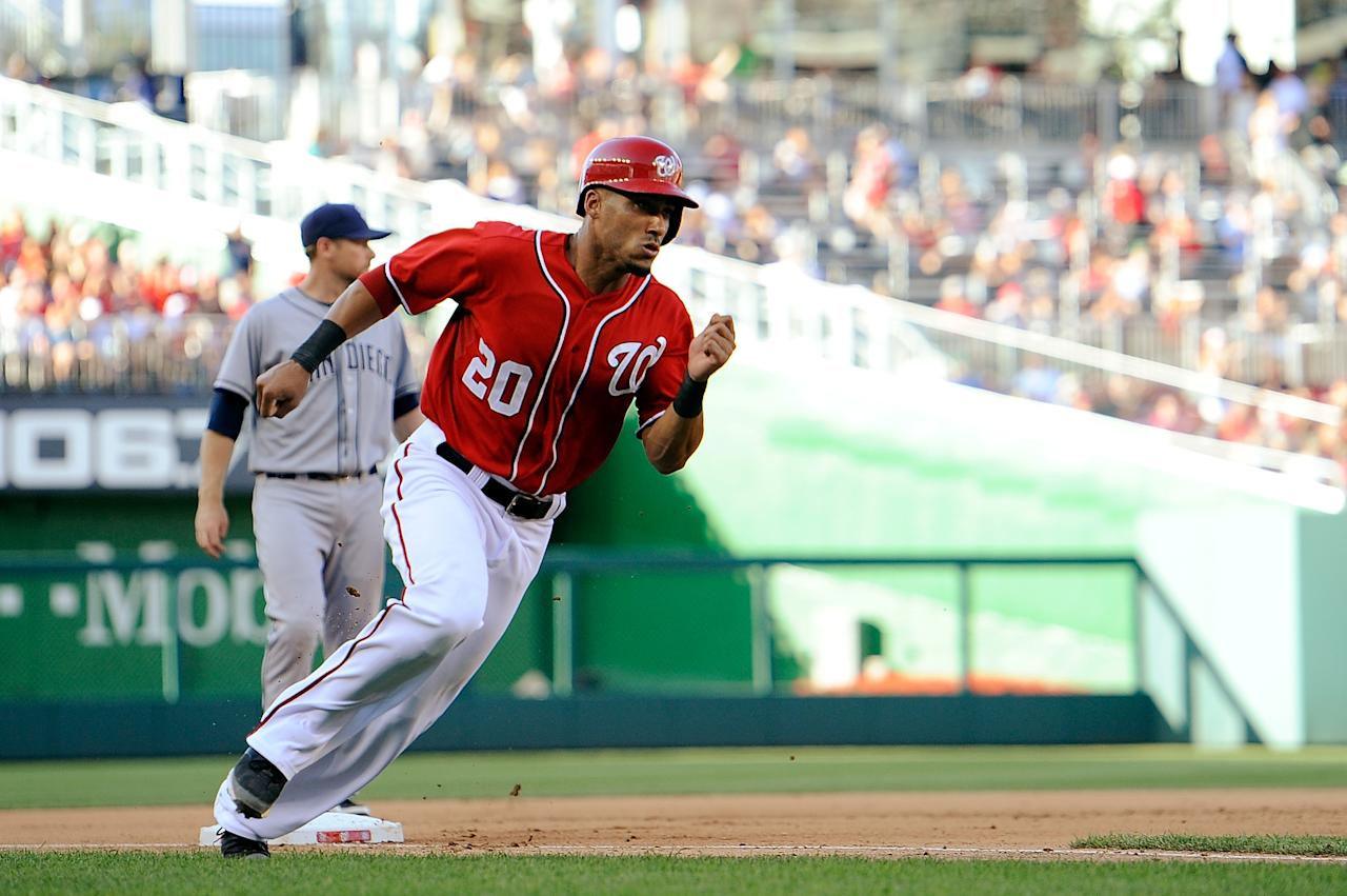 WASHINGTON, DC - JULY 06: Ian Desmond #20 of the Washington Nationals rounds third base on his way to score the game winning run on a single by Ryan Zimmerman #11 in the seventh inning of a game against the San Diego Padres at Nationals Park on July 6, 2013 in Washington, DC. (Photo by Patrick McDermott/Getty Images)