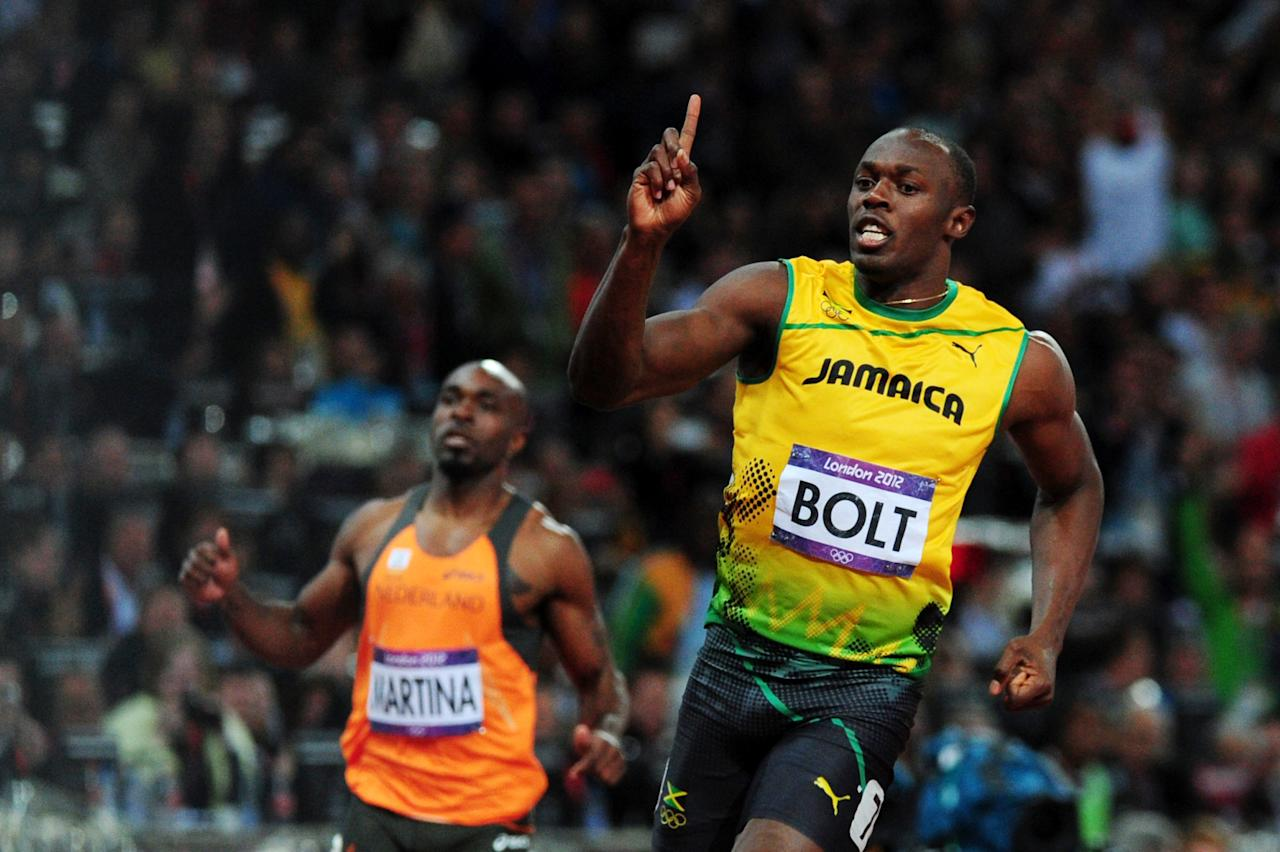 LONDON, ENGLAND - AUGUST 05:  Usain Bolt of Jamaica celebrates winning gold in the Men?s 100m Final on Day 9 of the London 2012 Olympic Games at the Olympic Stadium on August 5, 2012 in London, England.  (Photo by Stu Forster/Getty Images)