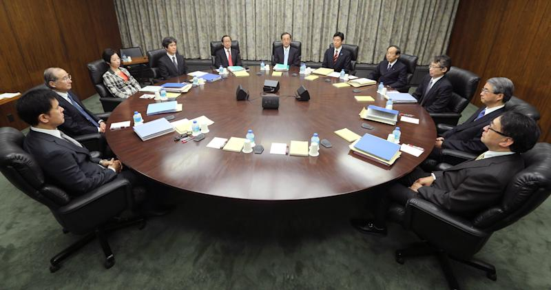 """Bank of Japan Gov. Masaaki Shirakawa, center, poses with the other members of Policy Board of the BOJ on the last day of their two-day meeting at its headquarters in Tokyo Tuesday morning, Jan. 22, 2013. Shirakawa vowed to achieve the inflation benchmark """"as soon as possible,"""" in cooperation with the government Tuesday. (AP Photo/Kyodo News)  JAPAN OUT, MANDATORY CREDIT, NO LICENSING IN CHINA, HONG KONG, JAPAN, SOUTH KOREA AND FRANCE"""