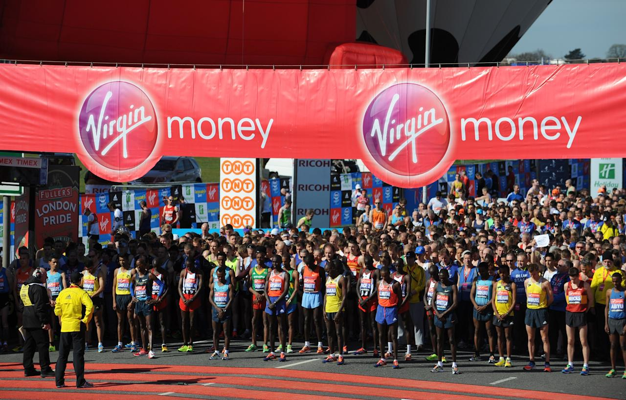 LONDON, ENGLAND - APRIL 21: Elite Men runners and fellow competitors observe a minutes silence in memory of victims of the Boston Marathon bombing at the start of the Virgin London Marathon 2013 on Blackheath Common on April 21, 2013 in London, England.  (Photo by Steve Bardens/Getty Images)
