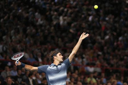 Federer serves to Del Potro in their quarterfinals match at the Paris Masters men's singles tennis tournament