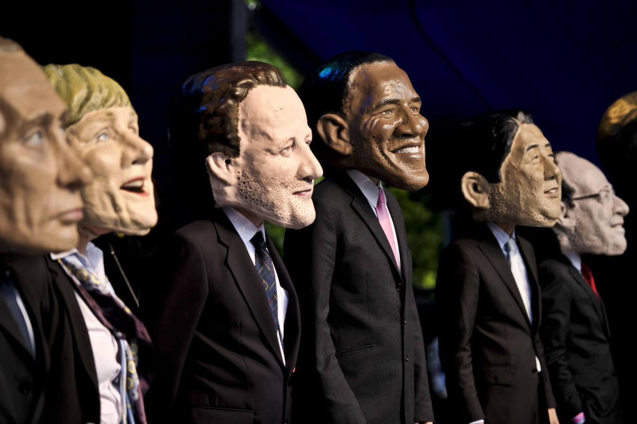 Large headed impersonators of the G8 politicians arrive onstage at Belfast Botanic Gardens, where the Big IF Belfast concert is taking place ahead of the G8 Summit in Northern Ireland.