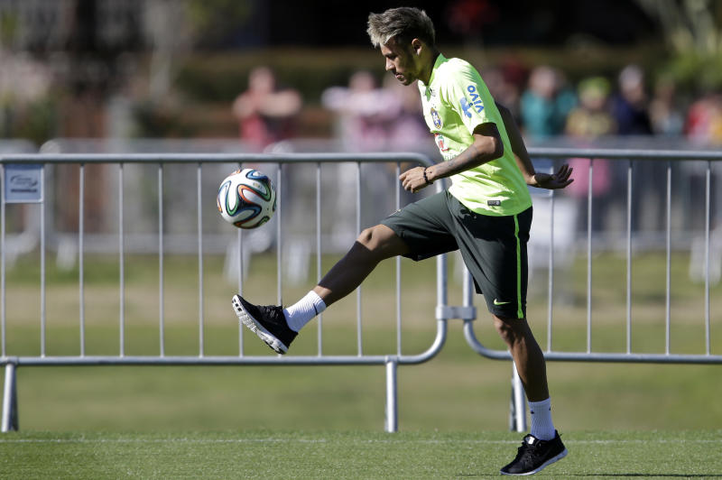 Brazil's Neymar practices during a training session in Teresopolis, Brazil, Wednesday, June 25, 2014. Brazil will face Chile on June 28 in the round of 16 of the 2014 soccer World Cup