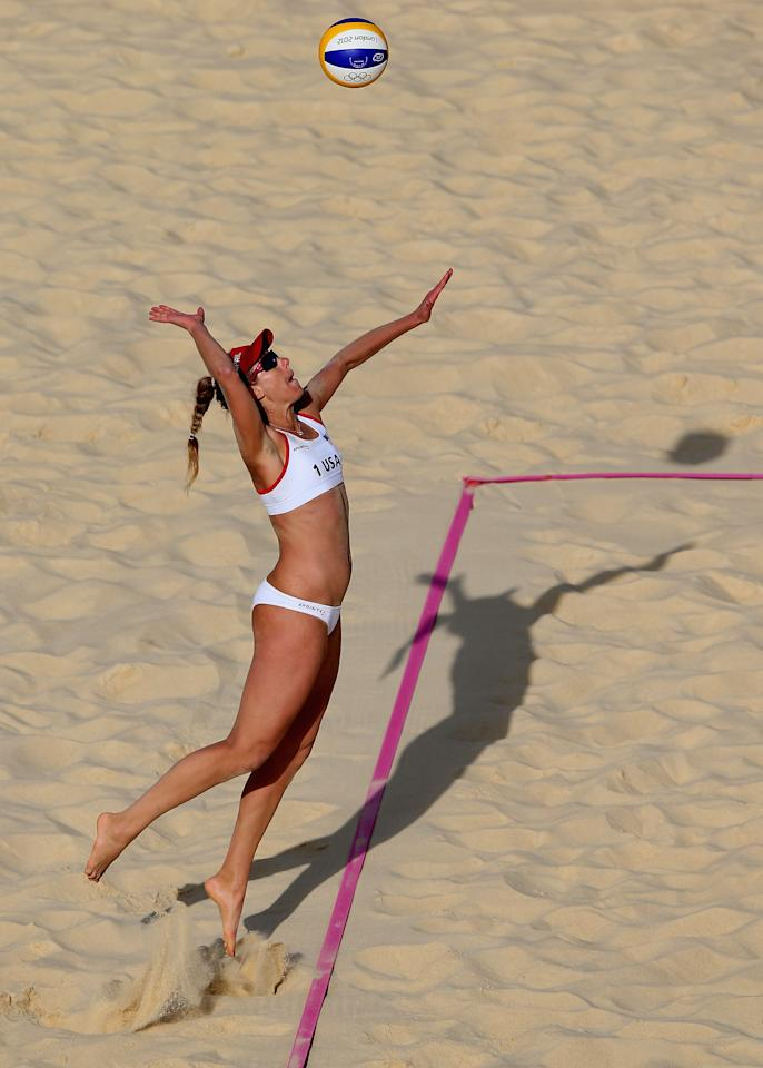 LONDON, ENGLAND - AUGUST 02:  April Ross the United States serves during the Women's Beach Volleyball preliminary match between United States and Spain on Day 6 of the London 2012 Olympic Games at Horse Guards Parade on August 2, 2012 in London, England.  (Photo by Ryan Pierse/Getty Images)