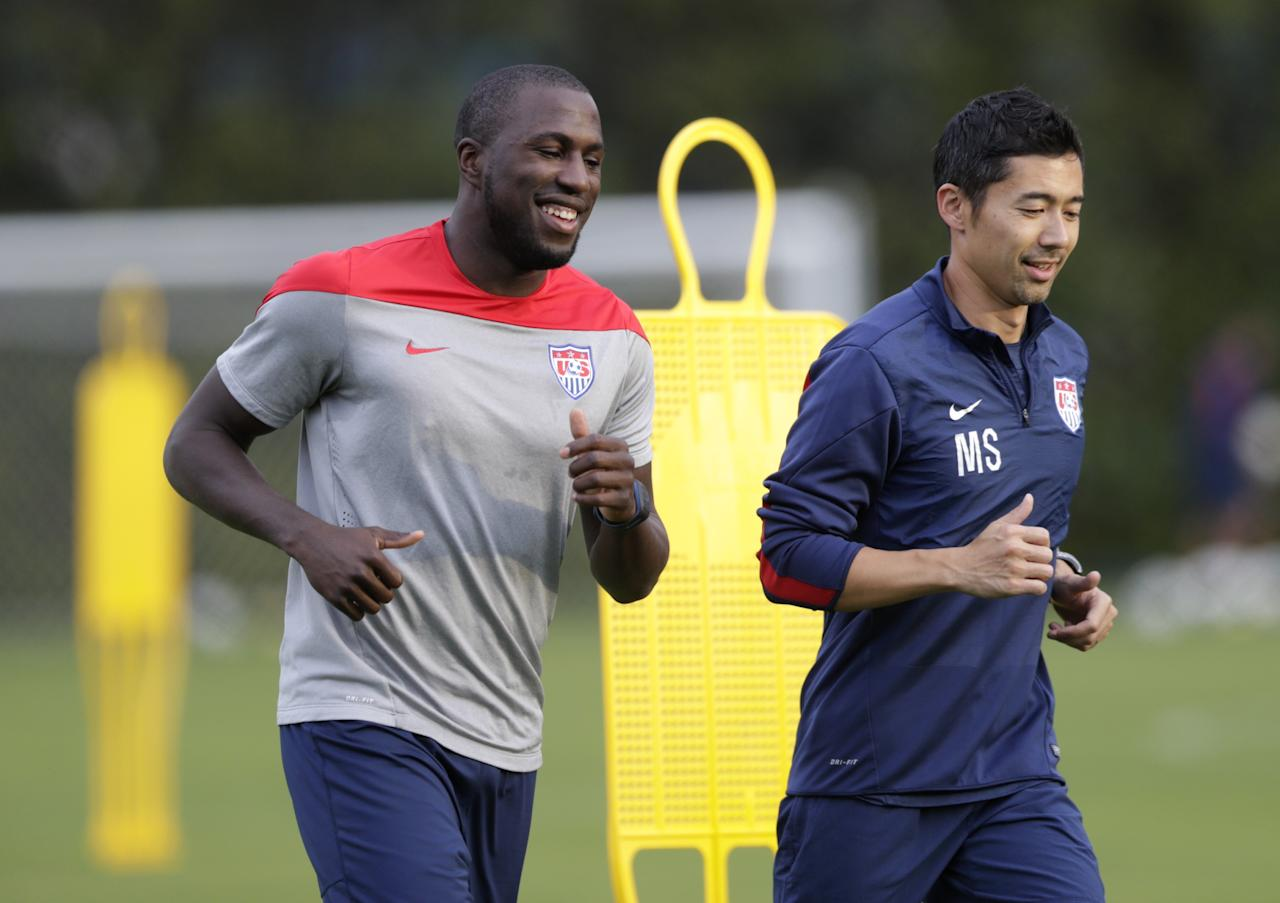 United States' Jozy Altidore, left, works out with trainer Masa Sakihana during a training session in Sao Paulo, Brazil, Saturday, June 28, 2014. The United States will play Belgium on Tuesday in the round of 16 of the soccer World Cup. (AP Photo/Julio Cortez)