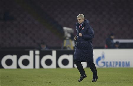 Arsenal's Coach Wenger leaves the pich at the half-time of the the Champions League soccer match against Naples at San Paolo stadium in Naples