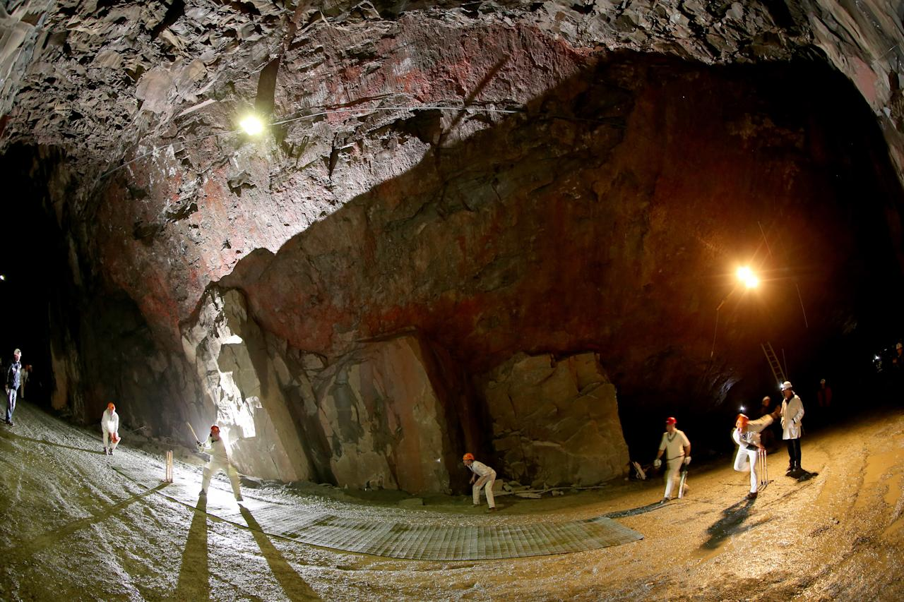 KESWICK, ENGLAND - DECEMBER 05:  Cricketers from village teams Threlkeld and Caldbeck take part in the world's first underground cricket match inside Honister Slate Mine on December 5, 2013 in Keswick, England. The Christmas fixture took part 600m (2,000ft) inside Fleetwith Pike at  Englands last working slate mine at Honister in the Lake District. The game is one of many unusual venues the teams have played in to raise money to fix Threlkeld Cricket Club's flood damaged ground. The match was won by Caldbeck Village.  (Photo by Christopher Furlong/Getty Images)
