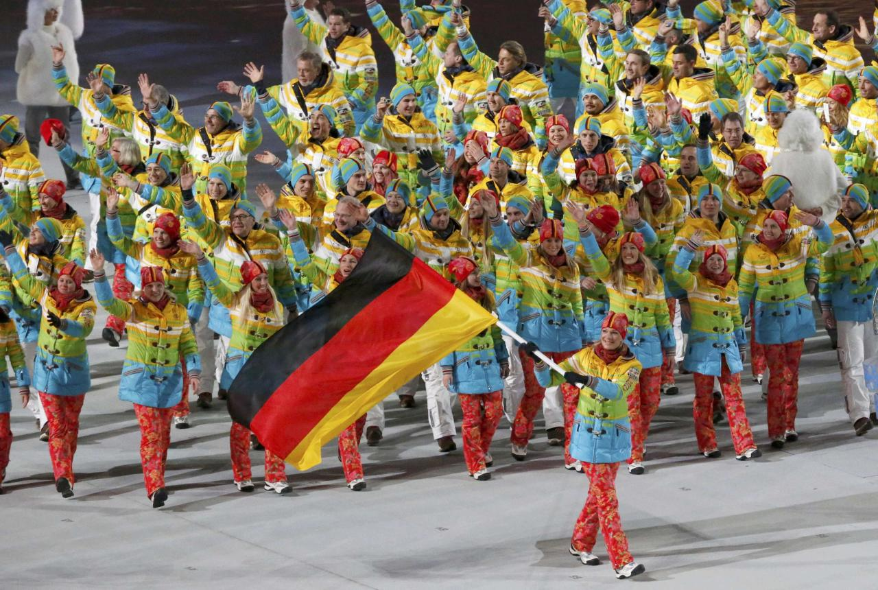 Germany's flag-bearer Maria Hoefl-Riesch leads her country's contingent during the opening ceremony of the 2014 Sochi Winter Olympics, February 7, 2014. REUTERS/Grigory Dukor (RUSSIA - Tags: OLYMPICS SPORT)