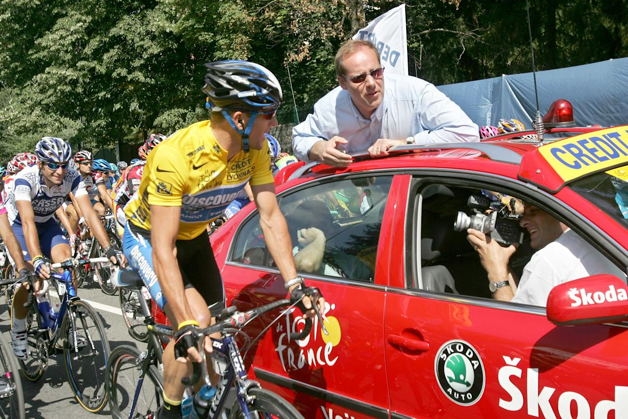 "FILE - In this July 20, 2005, file photo, overall leader Lance Armstrong, left, of Austin, Texas, talks with Tour de France vice director general Christian Prudhomme, of France, before Prudhomme gave the official start for the 17th stage of the Tour de France cycling race between Pau and Revel, southwestern France. Admitting he cheated was a start. Now, it's all about whether Armstrong is ready to give details, lots of them, to clean up his sport. ""We're left wanting more. We have to know more about the system,"" Prudhomme told the AP. ""He couldn't have done it alone. We have to know who in his entourage helped him to do this.""(AP Photo/Christophe Ena, File)"