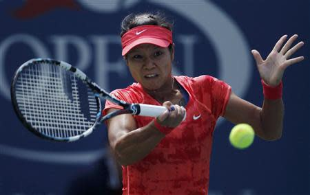 Li Na of China hits a return to Robson of Britain at the U.S. Open tennis championships in New York
