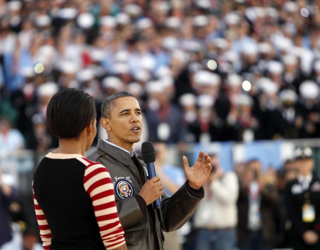 President Barack Obama speaks to the crowd as first lady Michelle Obama listens before the Carrier Classic NCAA college basketball game between Michigan State and North Carolina aboard the USS Carl Vinson, Friday, Nov. 11, 2011, in Coronado, Calif. (AP Photo/Lenny Ignelzi)