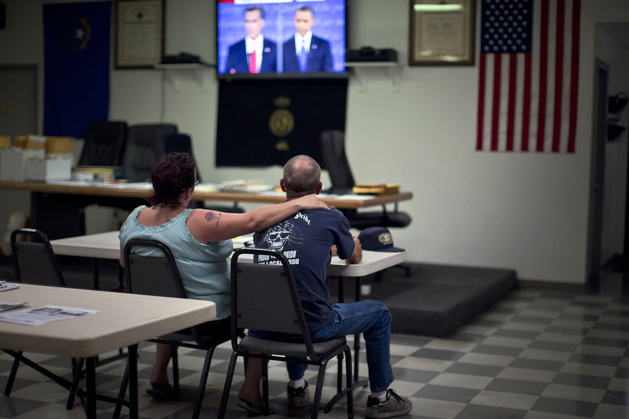 Dawn, left, and Randy Cornell, watch the presidential debate at the United Steelworkers Local 4856 Union Hall in Henderson, Nev. Small business owners just can't seem to get a clear picture about what's to come, whether it's the economy or the presidential race between President Barack Obama and challenger Mitt Romney. Both candidates know that small business owners are watching. During Wednesday's presidential debate, the candidates mentioned small business more than two dozen times.