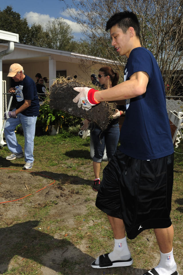 New York Knicks player Jeremy Lin, right, helps lay new sod around a home as part of the NBA Cares All-Star Day of Service on Feb 24, 2012 in Orlando, Fla. (Scott A. Miller/AP Images for Rebuilding Together)