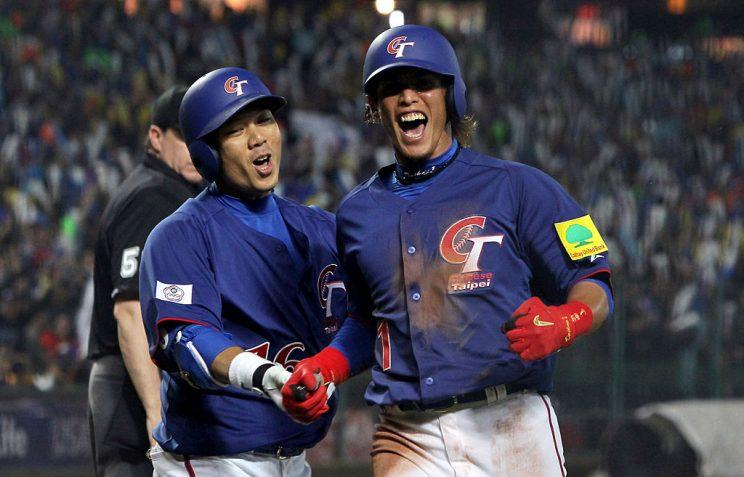 TAICHUNG, TAIWAN - MARCH 05: Yang Dai-Kang #1 of Chinese Taipei celebrates with Chou Szu-Chi # 16 in the third inning during the World Baseball Classic First Round Group B match between Chinese Taipei and South Korea at Intercontinental Baseball Stadium on March 5, 2013 in Taichung, Taiwan. (Photo by Chung Sung-Jun/Getty Images)