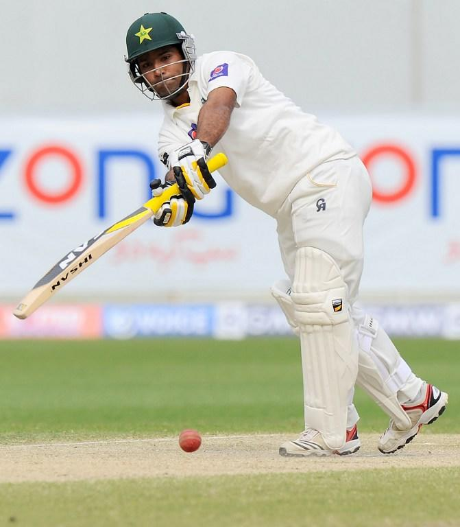 Pakistan batsman Asad Shafiq plays a shot during the fourth day of the second cricket Test match between Pakistan and Sri Lanka at the Dubai International Cricket Stadium in Dubai on January 11, 2014.  AFP PHOTO/Ishara S. KODIKARA