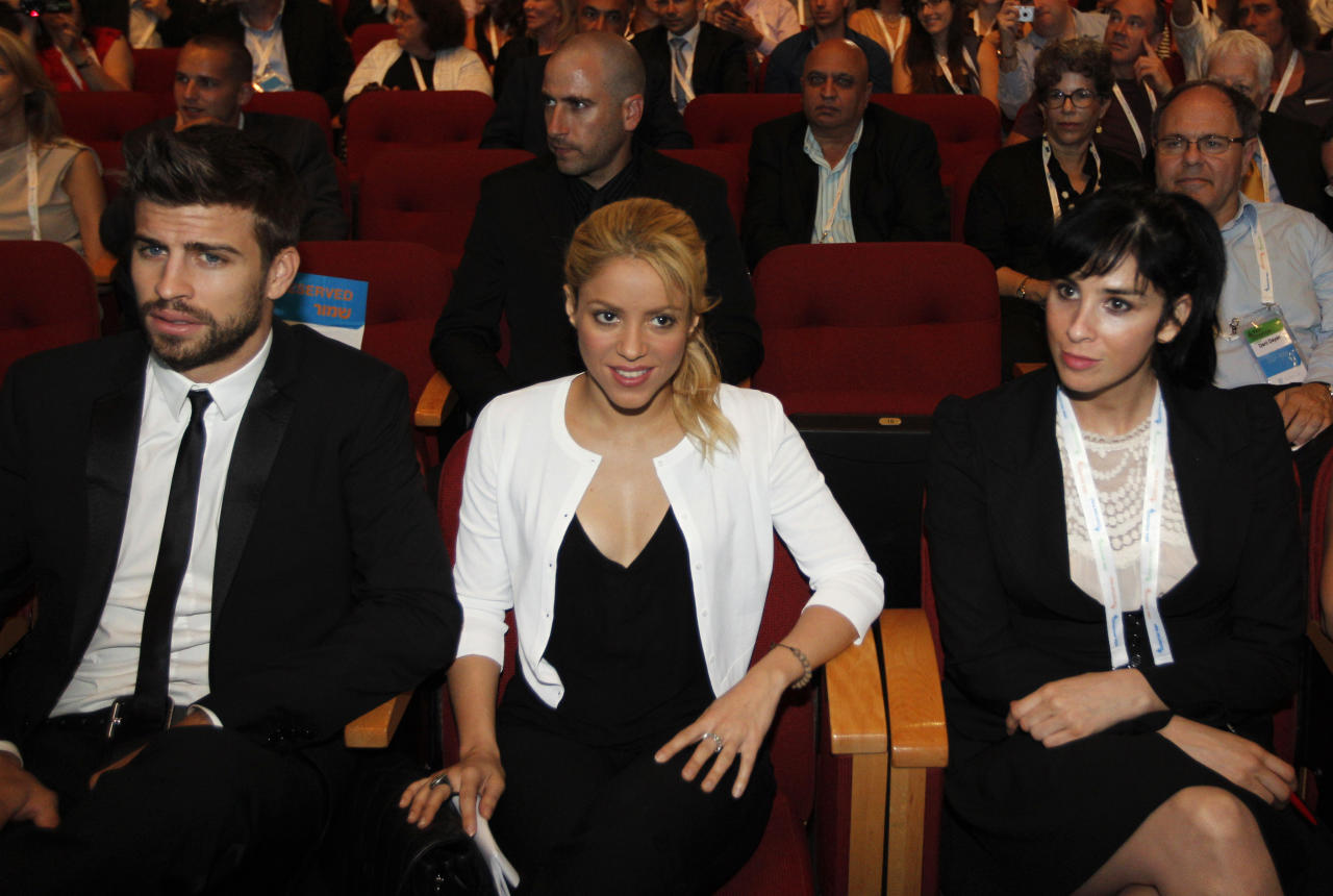 "Colombian singer Shakira, center, sits with her boyfriend FC Barcelona Gerard Pique, left, and U.S. comedian Sarah Silverman during a plenary session at the President's Conference in Jerusalem, Tuesday, June 21, 2011. Colombian pop singer Shakira promoted her global education campaign with a stop at a joint Israeli-Arab school in Jerusalem on Tuesday. Kicking off Israel's third annual President's Conference on Tuesday with a plea for children's education worldwide, Shakira, a U.N. Goodwill Ambassador, said the Holy Land was the ""perfect place to talk about how urgent it is to invest in education."" (AP Photo/Tara Todras-Whitehill, Pool)"