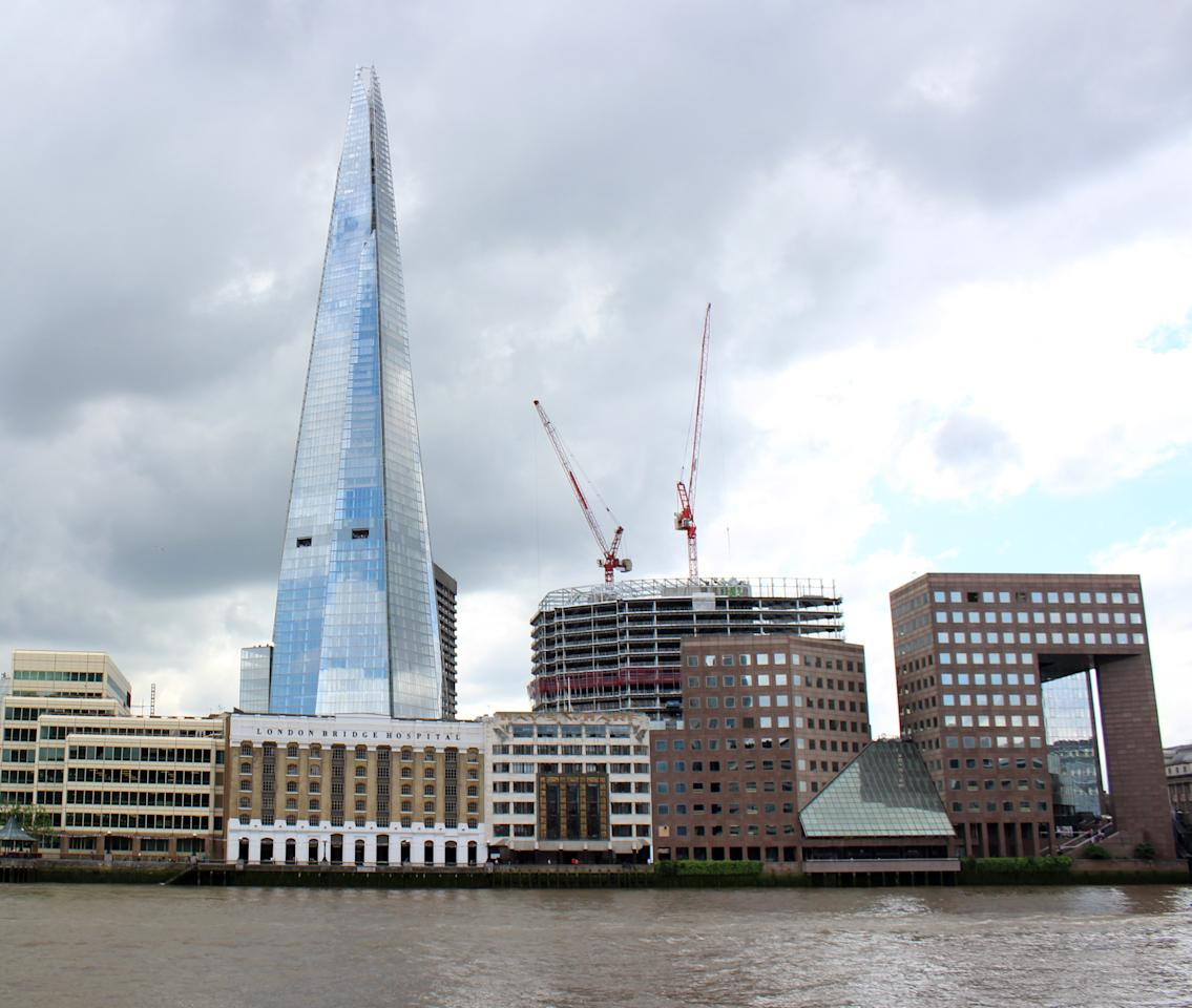 LONDON, ENGLAND - JULY 05:  A general view of the exterior of  the Shard from across the river, on Lower Thames Street on July 5, 2012 in London, England. The European Union's highest building, designed by Italian architect Renzo Piano, stands at 310 meters tall and as is situated on London's Southbank. The building was formally inaugurated with a laser show streamed live on the internet.  (Photo by Jesse Toksvig-Stewart/Getty Images)