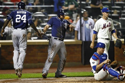 Padres break out offense after rain in 11-5 win