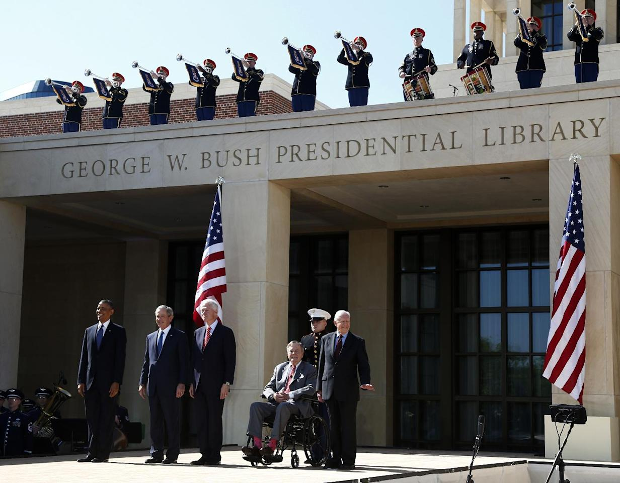 President Barack Obama stands with former presidents, from second from left, George W. Bush, Bill Clinton, George H.W. Bush, and Jimmy Carter at the dedication of the George W. Bush presidential library on the campus of Southern Methodist University in Dallas, Thursday, April 25, 2013. (AP Photo/Charles Dharapak)