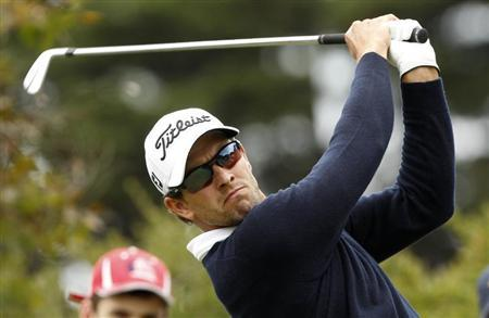 Scott plays a shot during the final round of the World Cup of Golf in Melbourne
