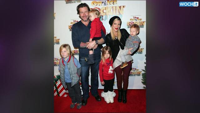 Tori Spelling And Dean McDermott Cuddle Up In 2014 New Year's Picture Amid Cheating Allegations