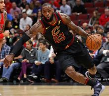 James's 60th career triple-double lifts Cavs over Jazz