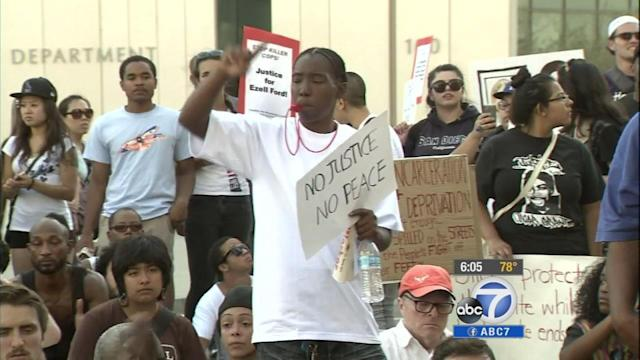 Protesters rally at LAPD headquarters over police shootings