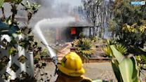 Calif. Wildfires Force Thousands To Flee Homes