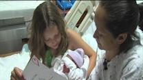 Young girl helps deliver baby brother