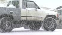 Snowy storm system whitens flood-weary areas of Colorado