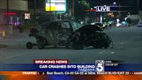 Car Crashes into Building, Catapults Engine Across Street