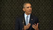 Obama returns to Illinois with message of political unity