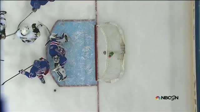 Henrik Lundqvist reacts in time for pad save