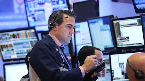 Dow drops 100 points; utilities fall nearly 2 percent