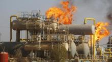 Oil down as Iraq says no cuts; Wall Street, Cushing draw limit loss