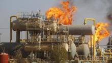 Oil down as Iraq says no cuts; Wall Street, Cushing draw limit loss