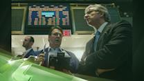 Latest Business News: Wall Street Edges Higher Despite McDonald's Disappointment