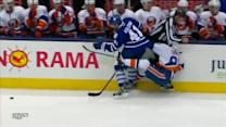 Nikolai Kulemin checks Tavares into referee