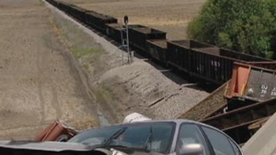 Raw: Train Derails After Overpass Collapse