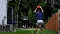 Basketball trick artist hits full court front flip shot