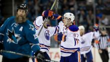 Oilers eliminate Sharks, get popcorn bath on bench