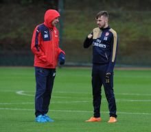 Arsenal's Aaron Ramsey defends Arsene Wenger against 'unfair' criticism
