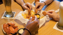 Chains like Buffalo Wild Wings and Papa John's should be worried about the NFL