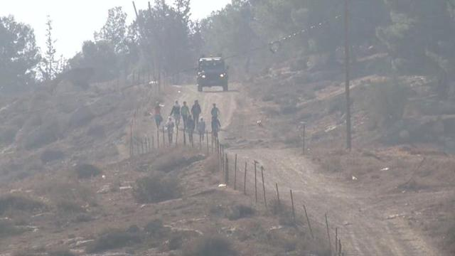Israel army protect Palestinian pupils from settlers