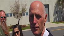 Gov. Scott axes nearly $400M from budget