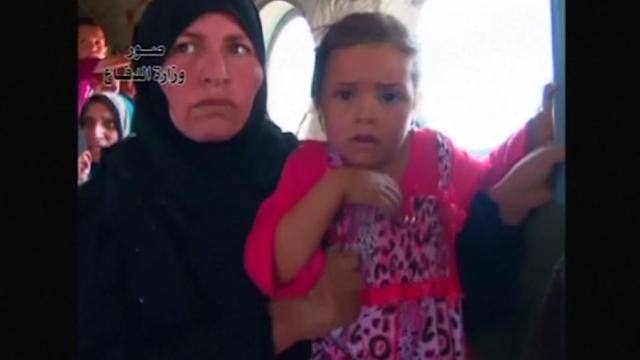 Iraq's military evacuate sick, children from besieged Shi'ite town of Amerli