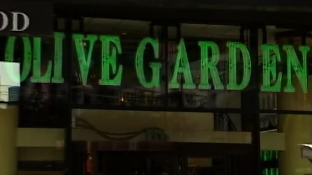 Olive Garden retreats on Obama health care law threats